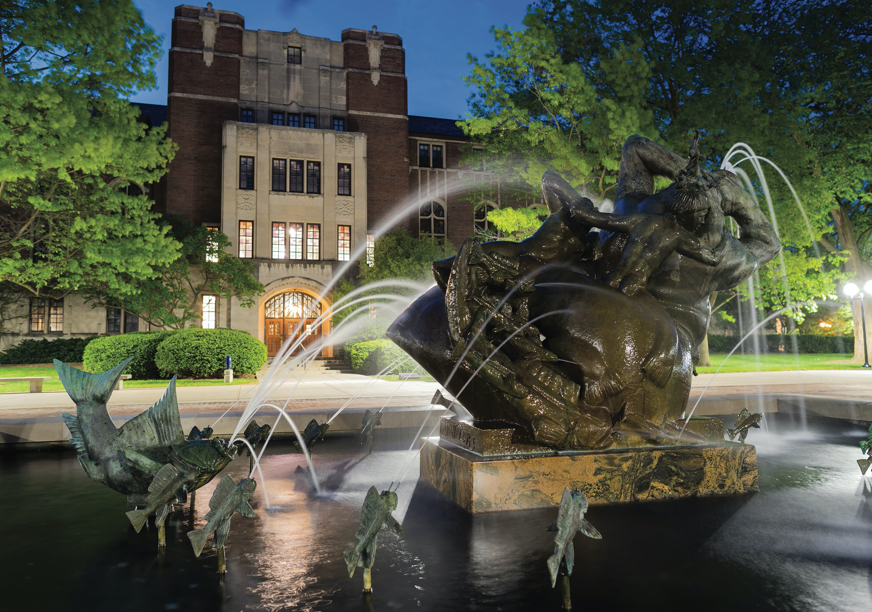 The fountain on Ingalls Mall in the spring, with the University League in the background.
