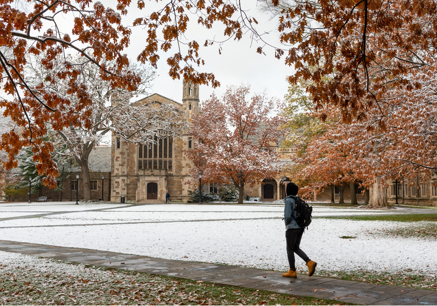 A student crosses U-M's famous Law Quad on a winter day.