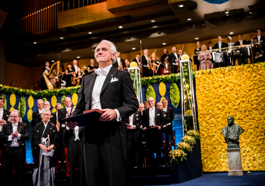 U-M professor Gerard Mourou at the Nobel Prize ceremony, receiving his award